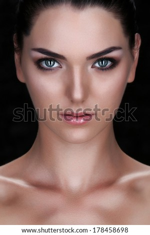 Beautiful Face of Young Woman with Clean Fresh Skin on black. Beauty Portrait. Beautiful Spa Woman.  Perfect Fresh Skin. Pure Beauty Model. Youth and Skin Care Concept  - stock photo