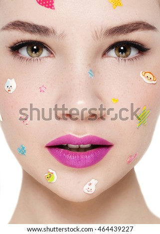 Beautiful Face of Young Woman with fun teen makeup close up isolated on white. Beauty Portrait. Perfect . Pure Model. Youth and Care Concept