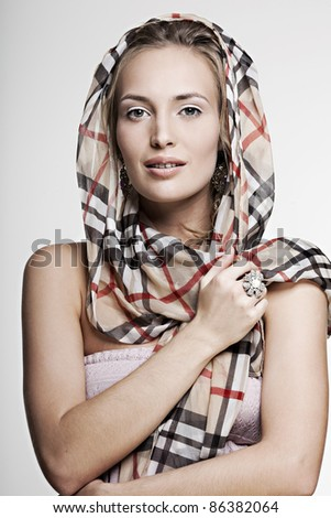 beautiful face smiling girl with perfect skin wearing jewelry - stock photo
