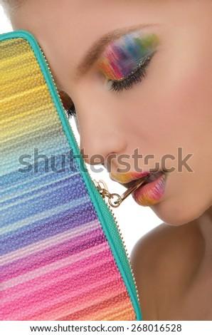 beautiful face with bright face-up and handbag closeup - stock photo