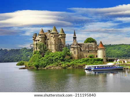 beautiful fairy castle in lake - Chateau de Val, France - stock photo