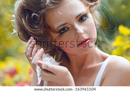 Beautiful fairy girl in a forest. Close portrait - stock photo