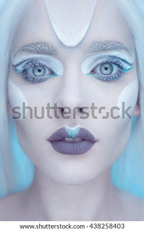 Beautiful fairy winter queen with frosted makeup