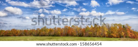 Beautiful fall colors drape this panorama landscape in northern Wisconsin - stock photo