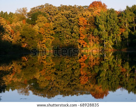 Beautiful fall colors reflect off a pond at Kettle Moraine State Forest in Wisconsin. - stock photo