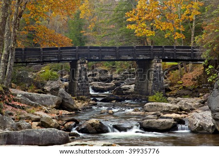 Beautiful Fall view of Glade Creek Bridge and Creek in Babcock State Park, West Virginia, USA - stock photo