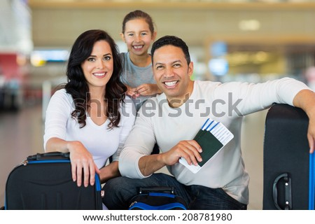 beautiful family at airport before boarding  - stock photo