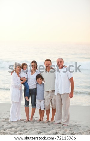 Beautiful family at the beach - stock photo