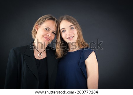 Beautiful family doing different expressions in different sets of clothes: posing - stock photo