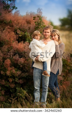 Beautiful family in a light sweater in park