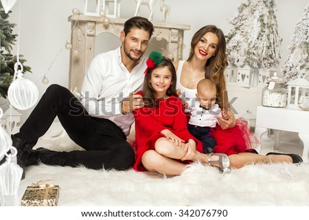 Beautiful Family in Christmas Scenery. Smiling Parents and Children - stock photo