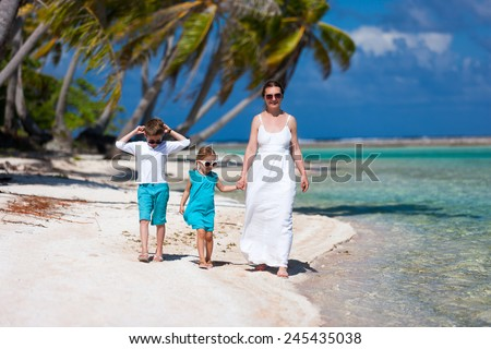 Beautiful family of mother and two kids on a deserted island - stock photo