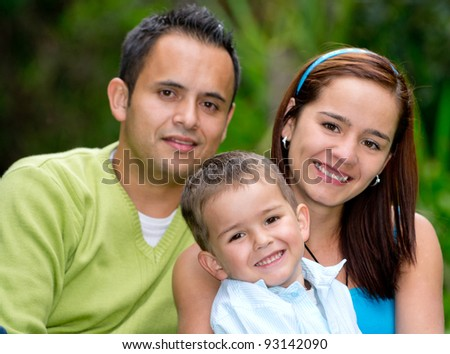 Beautiful family portrait at the park smiling