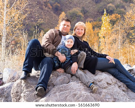 Beautiful family portrait in mountains
