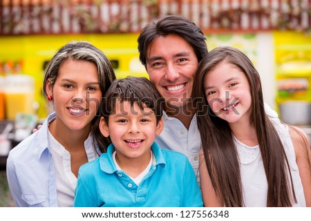 Beautiful family portrait looking very happy and smiling - stock photo
