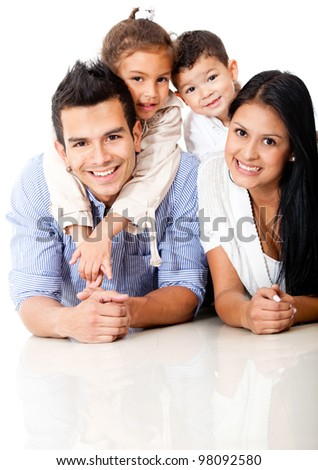 Beautiful family portrait lying on the floor and smiling - stock photo
