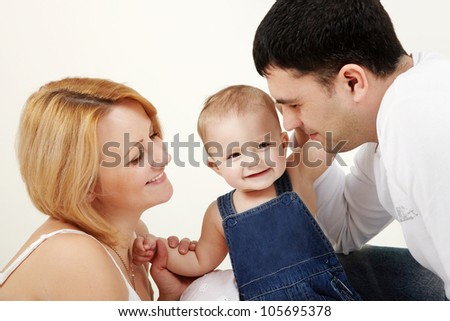 Beautiful family portrait lying on the floor - isolated over a white background - stock photo