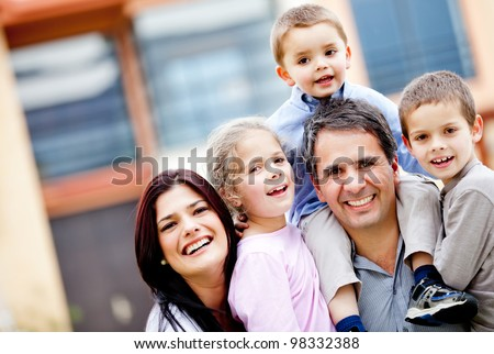 Beautiful family portrait smiling and looking very happy - stock photo