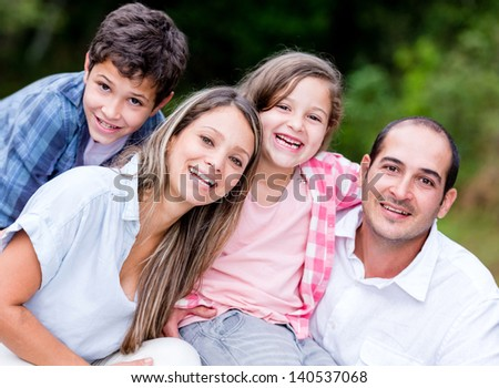 Beautiful family portrait spending time together outdoors