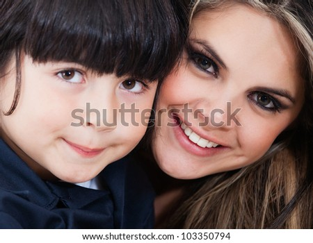 Beautiful family portrait with mother and son smiling