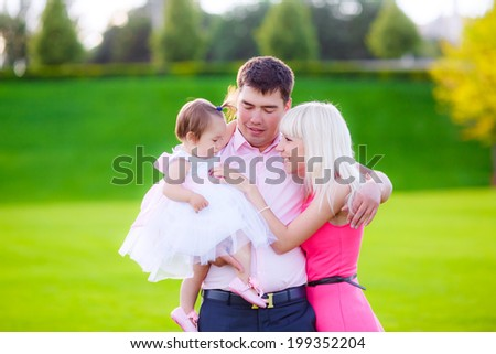 Beautiful family walk in nature with a child