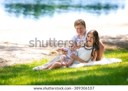 beautiful family with a baby in the park