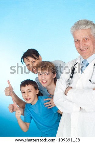 Beautiful family with children go to the doctor