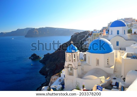 beautiful famous Santorini blue dome churches of Agios Spyridonas (St. Spiridon) and Anastasis (Resurrection) in Oia village - Santorini (Thira), Cyclades islands, Greece