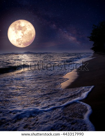 Beautiful fantasy tropical beach with Milky Way star in night skies, full moon - Retro style artwork with vintage color tone (Elements of this moon image furnished by NASA) - stock photo