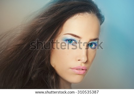 beautiful fantasy woman with blue eyes and makeup