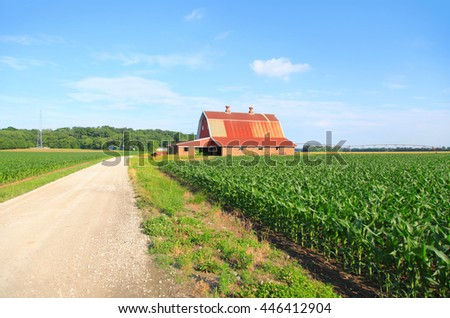 Beautiful farm landscape with red barn - stock photo