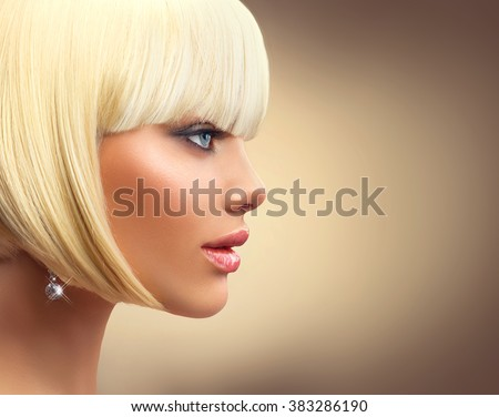 Beautiful Fashion blonde woman with Bob Haircut. Fringe Hairstyle. Dyed white hair. Hairdressing, Perfect makeup. Beautiful Model with Short Blond hair. Model Girl profile portrait on beige background - stock photo