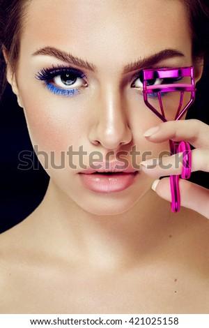 Beautiful Fashion Luxury Makeup, long eyelashes, perfect skin facial make-up. Beauty Brunette model woman holiday make up close up. Eyelash extensions - stock photo