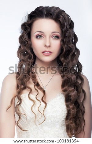 Beautiful  fashion model brunette. Hair, makeup, styling and retouching by professionals - stock photo