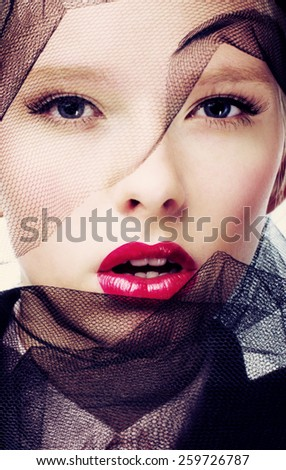 Beautiful fashion model face with veil