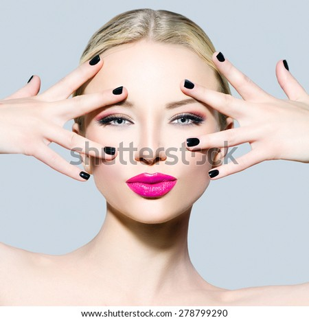 Beautiful fashion model girl with blond hair, darl manicure and bright make up. Portrait of glamour woman with makeup over grey background. Beauty female face close up with perfect make-up - stock photo
