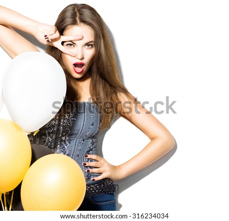 Beautiful fashion model girl with colorful balloons posing isolated on white background. Beauty girl showing peace v-sign or victory gesture. Model with perfect make-up posing in studio with balloons - stock photo