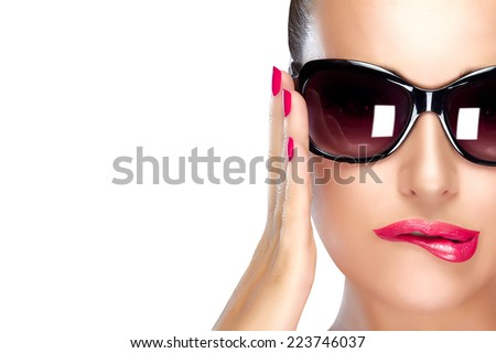Beautiful fashion model girl with stylish oversized black sunglasses. Bright makeup and manicure. High fashion portrait isolated on white with copy space for text. Beauty and fashion concept.