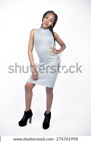 Beautiful fashion model in a grey dress