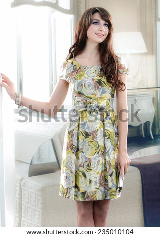 Beautiful fashion model in modern dress posing - stock photo