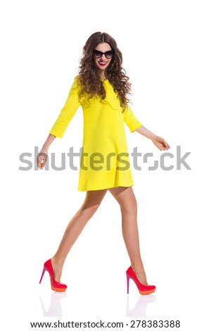 Yellow dress red heels