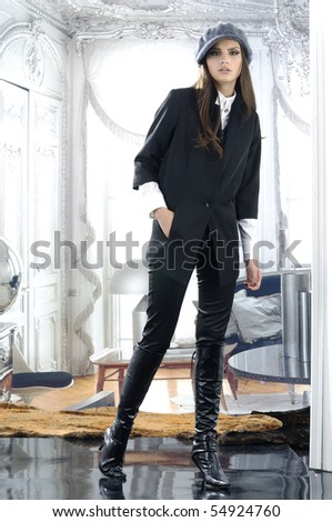 Beautiful fashion model posing in the studio - stock photo