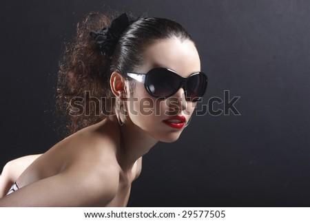 beautiful fashion model posing with attitude - stock photo