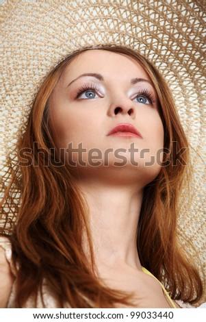 Beautiful Fashion Model Wearing A Retro Summer Hat, isolated - stock photo