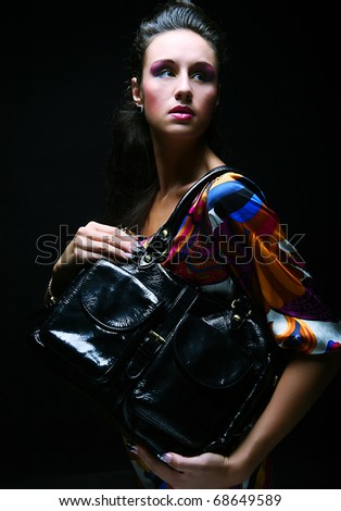 Beautiful fashion model with a bag