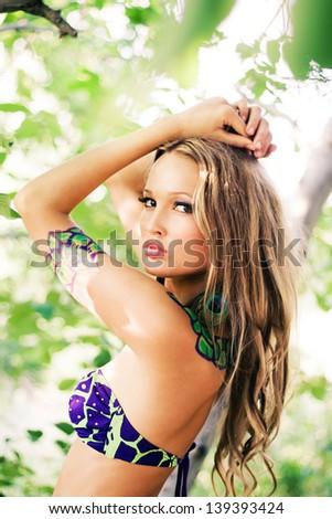 Beautiful fashion model with body-art. Outdoors portrait - stock photo