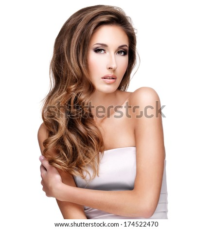 Beautiful fashion model with gorgeous long hair and makeup posing at studio. Isolated on white background. - stock photo