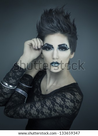 Beautiful fashion model with short stylish hair and creative makeup and cosmetics