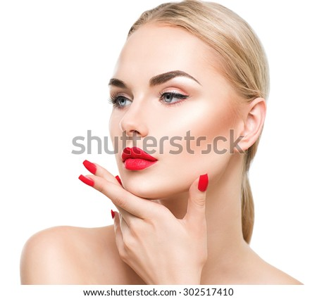 Beautiful fashion model Woman with blond hair. Red lipstick and nails. Portrait of glamour girl with bright makeup isolated on white background. Beauty female face close up with perfect make up - stock photo