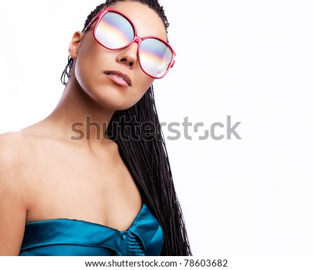 beautiful fashion mulatto woman wearing sunglasses over a white background.